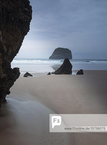 Rocks on tranquil ocean beach Borizo Beach Asturias Spain