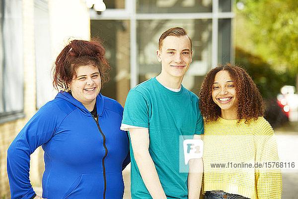 Portrait confident smiling college students