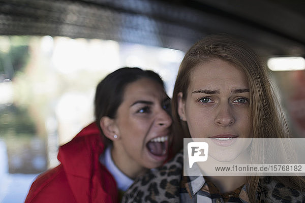 Angry young woman yelling at friend