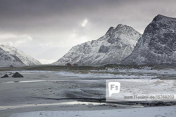 Scenic view snow covered mountains Skagsanden Lofoten Norway