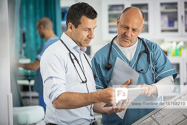 Male doctors using digital tablet in hospital Male doctors using digital tablet in hospital