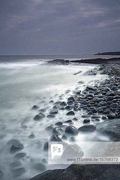 Rocks mystical ocean Cullernose Point Craster Northumberland UK