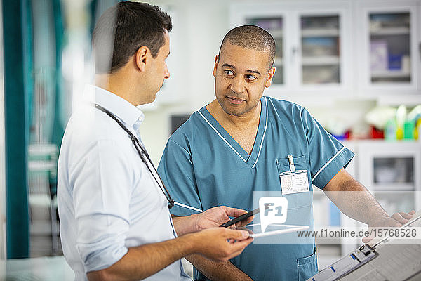 Male doctor and nurse talking in hospital