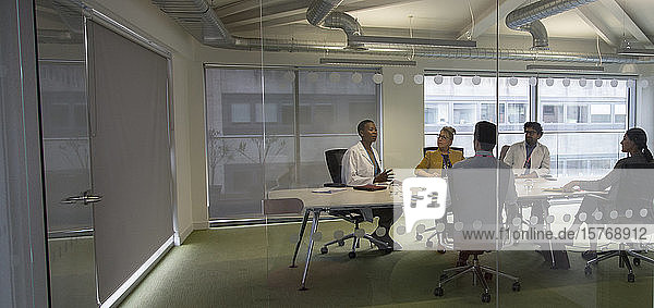 Doctors and administrators talking in conference room meeting Doctors and administrators talking in conference room meeting