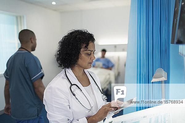 Female doctor using digital tablet in hospital room Female doctor using digital tablet in hospital room