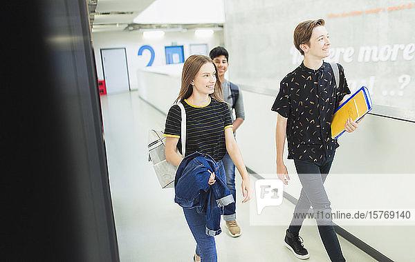 Junior high students walking in corridor Junior high students walking in corridor
