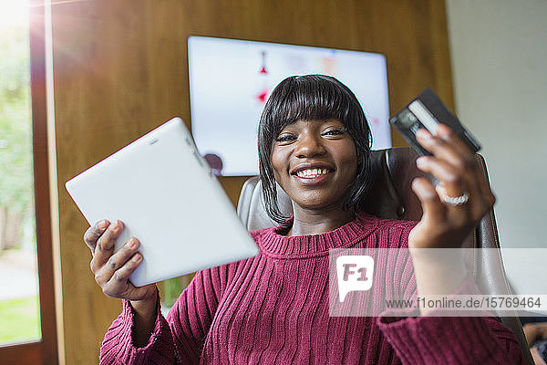 Portrait happy young woman online shopping with digital tablet
