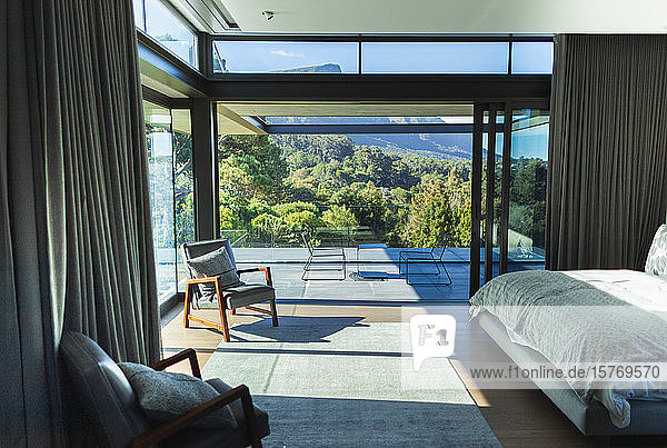 Modern home showcase bedroom and patio with scenic view
