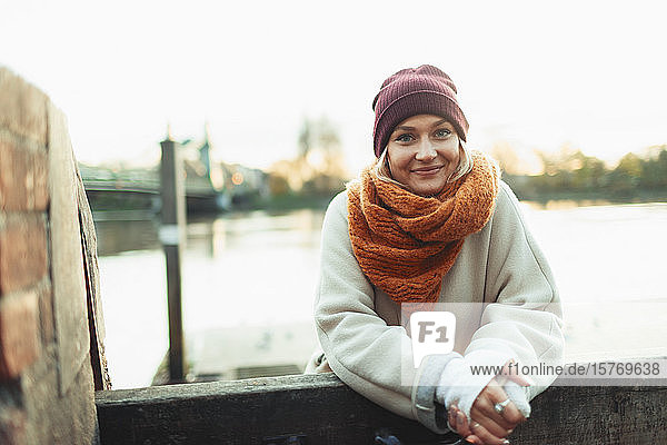 Portrait confident young woman in stocking cap and scarf