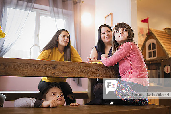 Family waiting at dining table