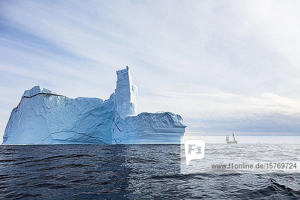 Majestic iceberg formation over sunny blue Atlantic Ocean Greenland