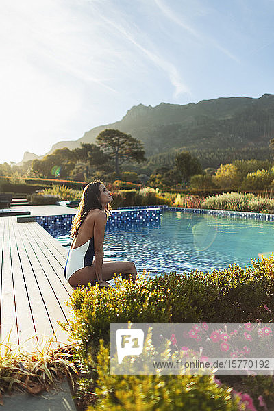 Serene woman in bathing suit relaxing at idyllic  tranquil swimming pool  Cape Town  South Africa