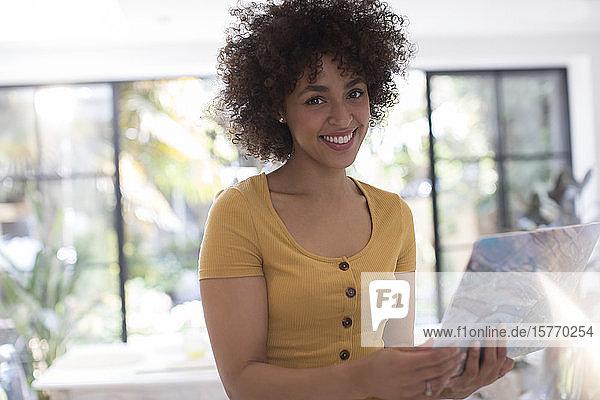 Portrait confident smiling young woman using laptop