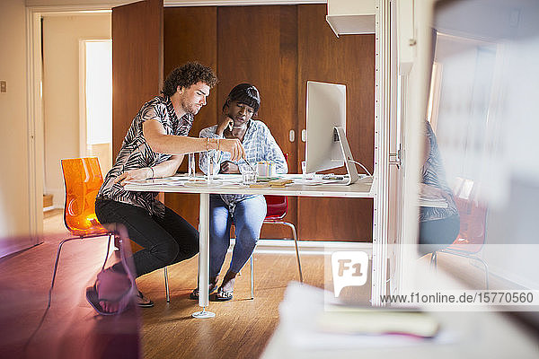 Young multiethnic couple working in home office