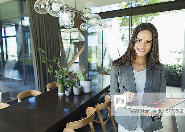 Portrait confident businesswoman working at home