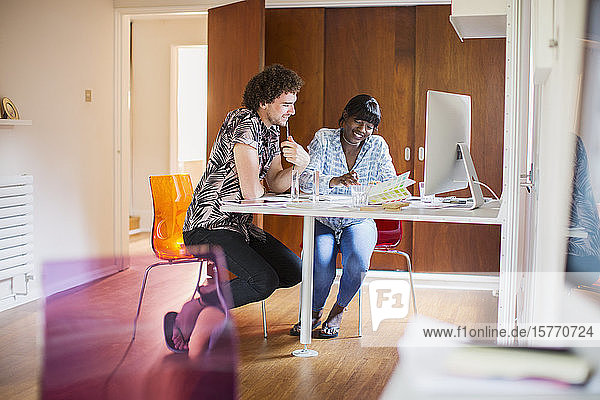 Young creative entrepreneurs working in home office