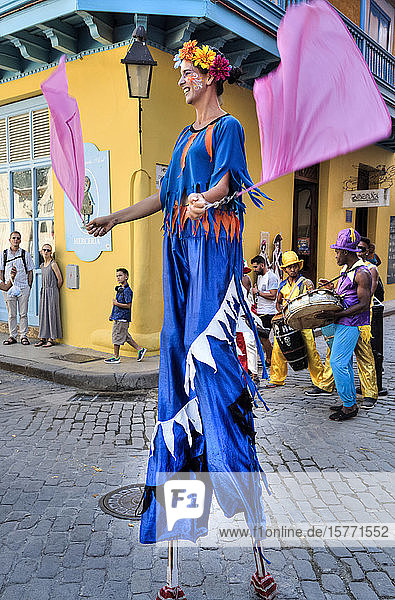 Stilt dancer and musicians in the street  Old Town; Havana  Cuba