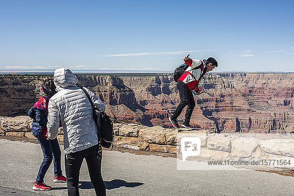 Tourists pretending to fall into the Grand Canyon from Mohave Point  South Rim; Arizona  United States of America