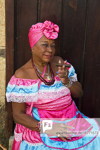 Cuban woman with cigar  Old Town; Havana  Cuba