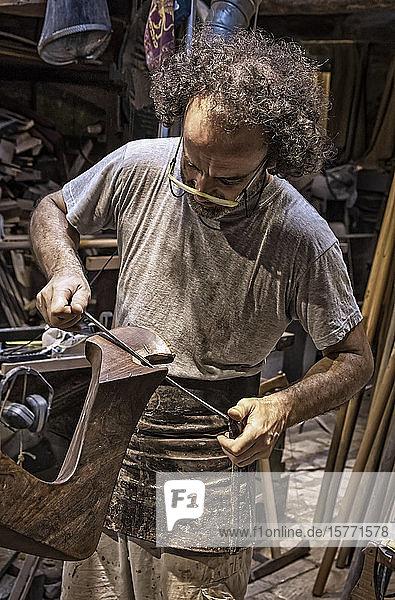 Craftsman working on a forcola (Venetian rowlock)  Paolo Brandolisio's workshop; Venice  Italy