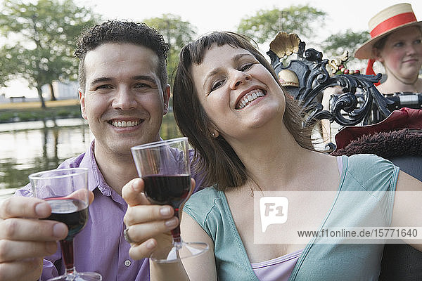 Portrait of a mid adult couple holding glasses of wine