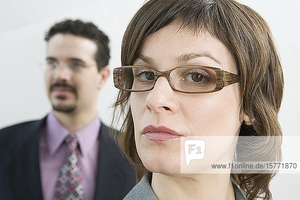 Portrait of a businesswoman with her colleague behind her