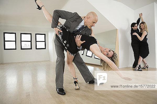 Mid adult couple dancing Argentine Tango