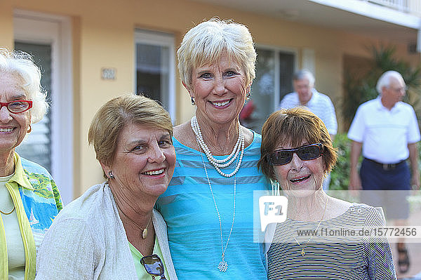 Three senior women pose for a picture together