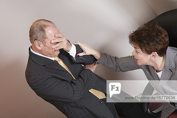 View of a business woman consoling business man.
