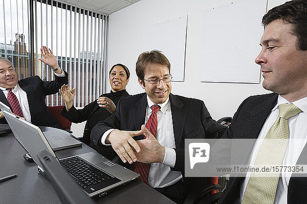 View of business people celebrating in an office.