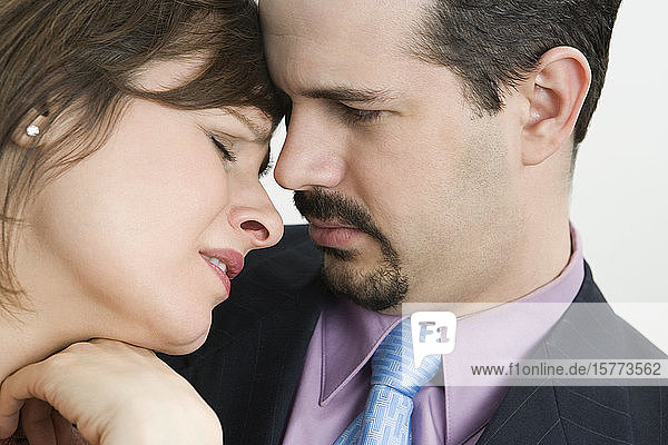 Businessman consoling a businesswoman