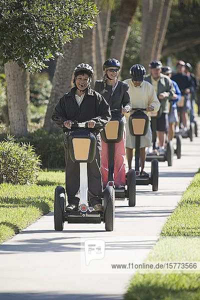 Tourists riding segways in a garden