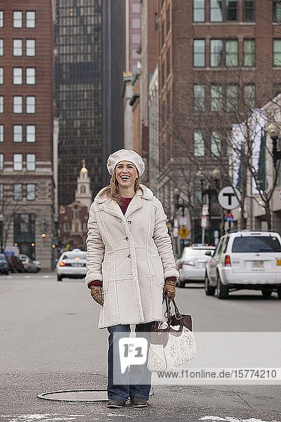 Portrait of a woman standing on a city street; Boston  Massachusetts  United States of America