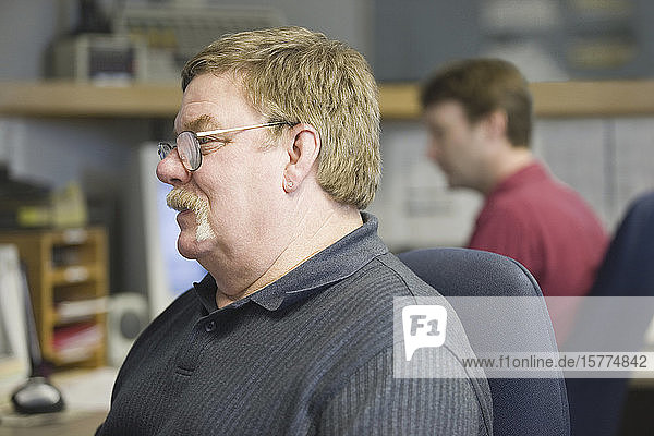 Close-up of a mature man in a control room