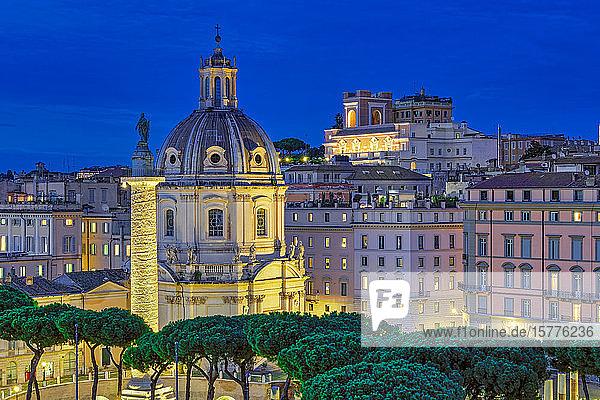 Trajans Column (Colonna Traiana) and Chiesa del Santissimo Nome di Maria al Foro Traiano at blue hour elevated view  Rome  Lazio  Italy  Europe