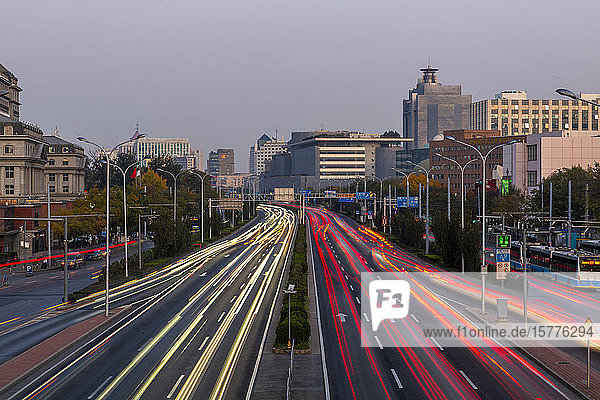 Traffic trail lights on major road near Beijing Zoo at dusk  Beijing  People's Republic of China  Asia