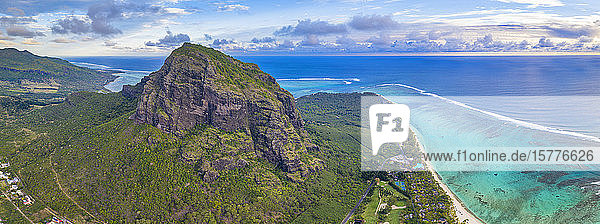 Majestic mountain overlooking the ocean and coral reef  aerial panoramic  Le Morne Brabant peninsula  Mauritius  Indian Ocean  Africa