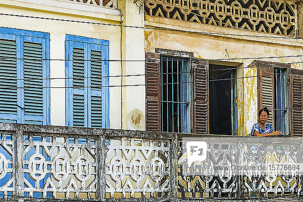 Faded balconies and shutters on a street in this old formerly French colonial river port  Kampot  Kampot Province  Cambodia  Indochina  Southeast Asia  Asia