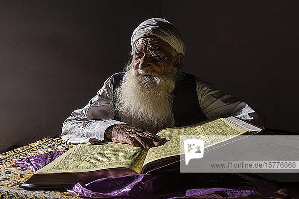 Sufi priest studying the holy Quran in the Shrine of Mawlana Abdur Rahman Jami  Herat's greatest 15th century poet  Herat  Afghanistan  Asia