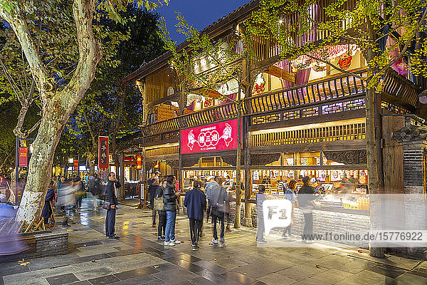 Shoppers in Kuanxiangzi Alley at night  Chengdu  Sichuan Province  People's Republic of China  Asia