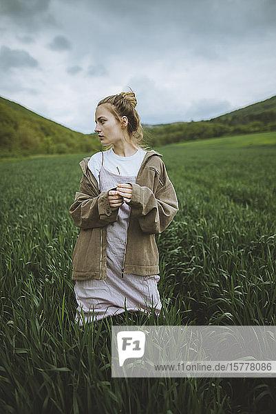 Woman wearing jacket in field in Crimea  Ukraine