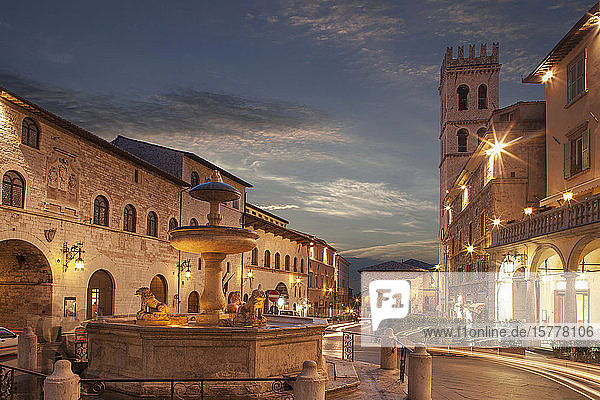 Fountain in Piazza del Comune at sunset in Assisi  Italy