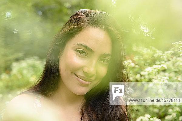 Smiling woman by bush
