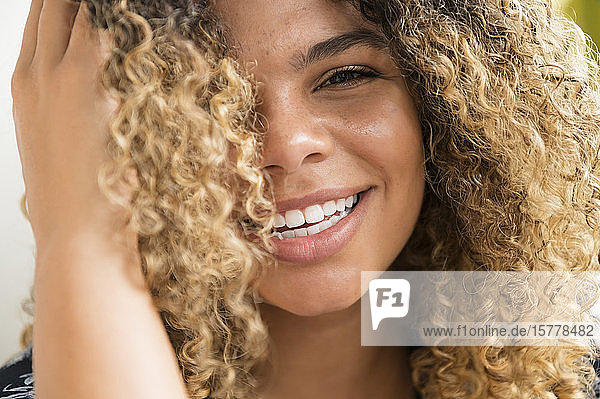Smiling woman touching her hair