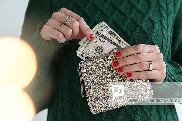 Woman holding purse with money