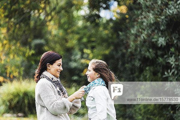 Mother adjusting daughter's scar