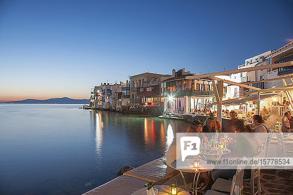 Waterfront restaurants at night in Mykonos  Greece