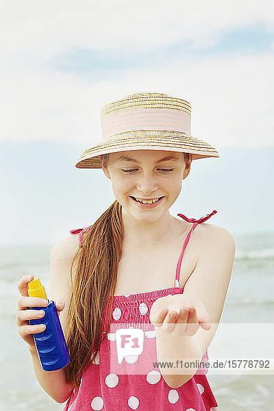 Girl using sun cream