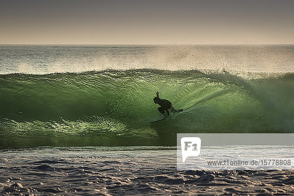 Surfer surfing on barreling wave  Crab Island  Doolin  Clare  Ireland