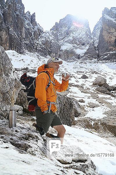 Hiker having warm drink  Canazei  Trentino-Alto Adige  Italy